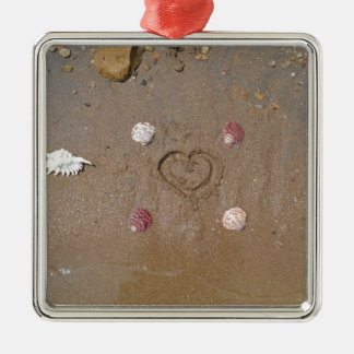 heart in the sand with shells metal ornament