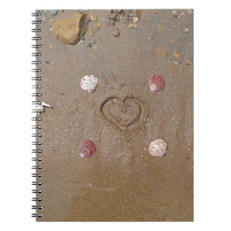 heart in the sand with shells spiral notebook