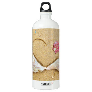 heart in the sand with shells water bottle