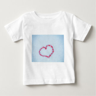 heart in the snow made of Red holly berries. T-shirt