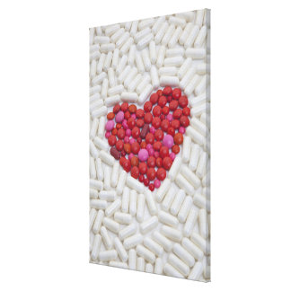 Heart made of red pills canvas print