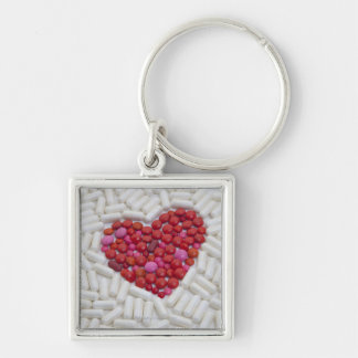 Heart made of red pills keychain