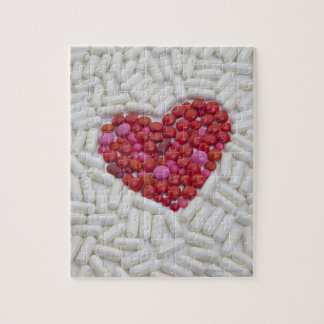 Heart made of red pills jigsaw puzzles