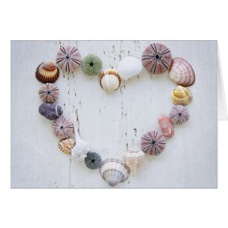 Heart of seashells and rocks card
