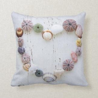 Heart of seashells and rocks throw pillow