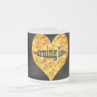 Heart on fire, decorates this frosted mug. frosted glass coffee mug
