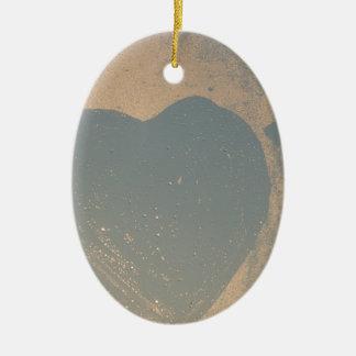 Heart on foggy window ceramic ornament