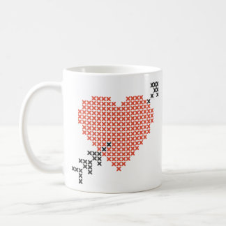 Heart pierced by an arrow. coffee mug