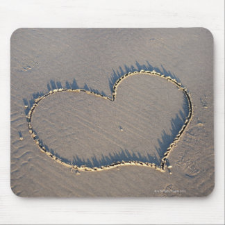 Heart shape drawn in the sand. mouse pad