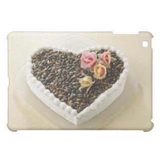 Heart shape wedding cake with flower, close-up iPad mini cases