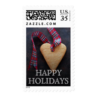 Heart-shaped cookie with ribbon postage stamps