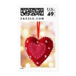 Heart-shaped felt decoration, close up postage stamps