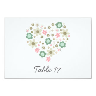heart shaped pink flowers meadow table number