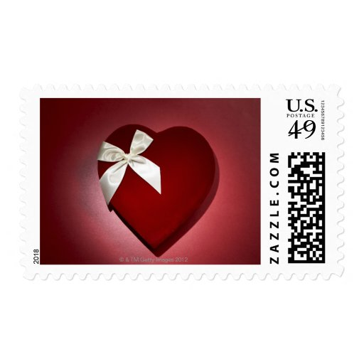 Heart shaped velvet box with ribbon postage