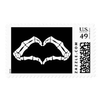 Heart skeleton hand sign postage stamp