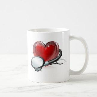 Heart symbol and stethoscope mugs