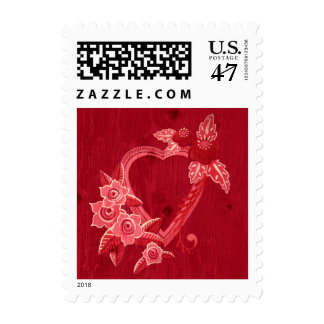 Heart with folk flower on red wood postage