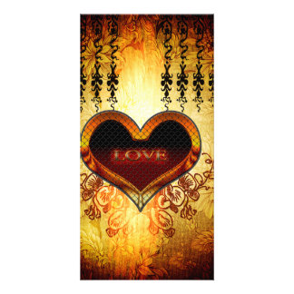 Heart with the word love on vintage background card