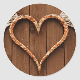 Heart with Wings Against Rustic Wooden Boards Round Sticker