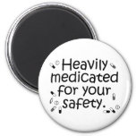 Heavily medicated for your protection fridge magnet