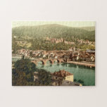 """Heidelberg I, Baden-W&#252;rttemberg, Germany Jigsaw Puzzle<br><div class=""""desc"""">A vintage image of a general view of Heidelberg in Baden-W&#252;rttemberg, Germany which was taken towards the end of the 19th century. The photograph was taken from Philosophers&#39; Way (Philosophenweg) and features the old historical buildings of the area, including the old arch bridge over River Neckar. Photograph courtesy of the...</div>"""