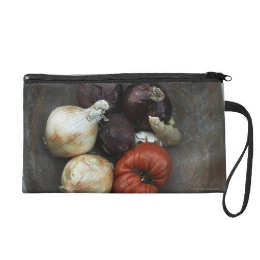 Heirloom tomato, yellow onion, red onion, ginger wristlet