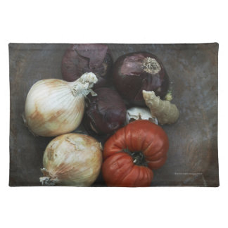 Heirloom tomato, yellow onion, red onion, ginger cloth placemat