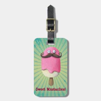 Helado rosado con los bigotes etiquetas maletas