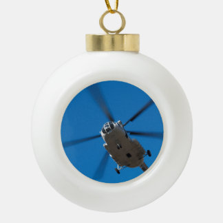 Helicopter Hovering in Blue Sky Ceramic Ball Christmas Ornament