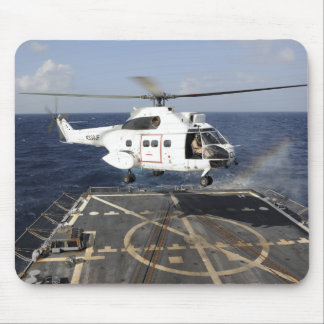 Helicopter lands aboard the Arleigh Burke-class Mouse Pad