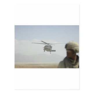 Helicopter picking up troops postcard