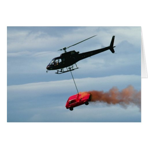 Helicopter transporting burning vehicle greeting card