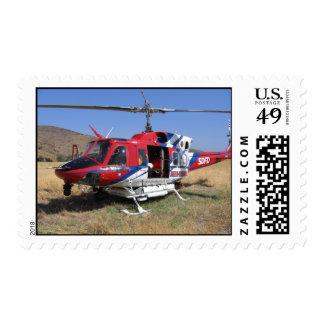 Helicóptero del fuego del cuerpo de bomberos de franqueo