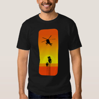 Helicóptero y puesta del sol playera