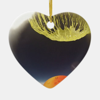 Helium balloon popping on the edge of space ceramic ornament