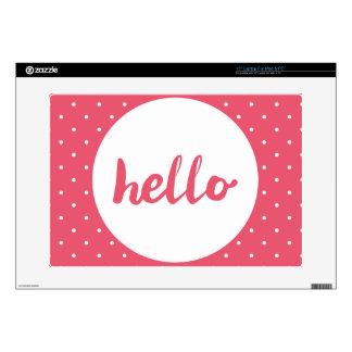 Hello on pastel pink polka dots background laptop skin