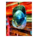 Helmet Hanging on Fire Truck Postcard