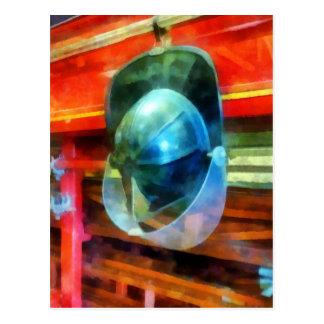 Helmet Hanging on Fire Truck Post Card