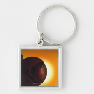 Helmeted Astronaut Against the Sun Keychain