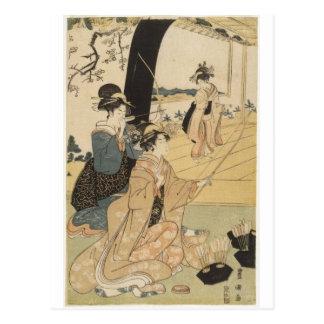 Hembras japonesas que practican el tiro al arco C. Postales