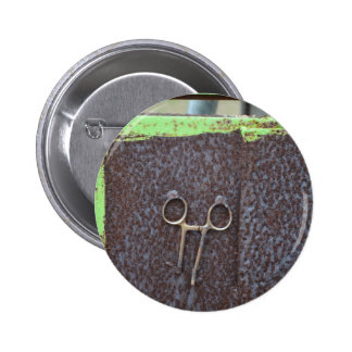 hemostat rusting metal grunge work 2 inch round button