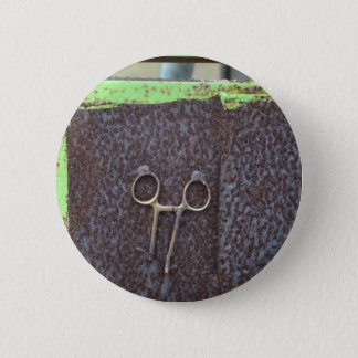 hemostat rusting metal grunge work button