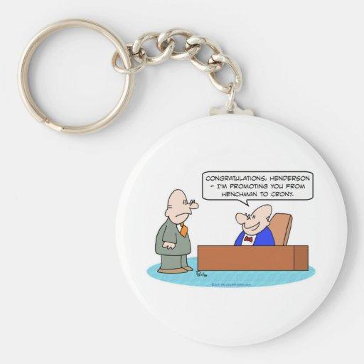 henchman crony promoting businessman keychains