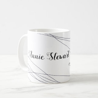 her name handwritten with thin curves on white coffee mug