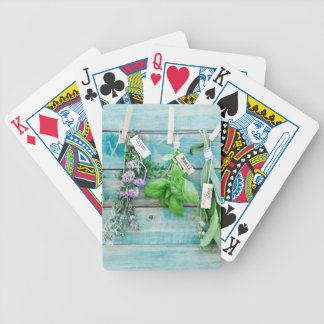 herbals en la pared de madera pintada turquesa del barajas de cartas