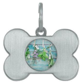 herbals on vintage turquoise painted wood wall pet ID tag