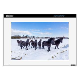"Herd of black frisian horses in winter snow decals for 15"" laptops"
