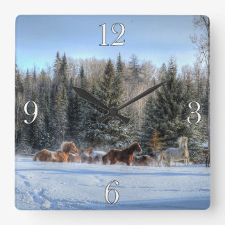 Herd of Horses Running in First Winter Snow Square Wall Clock
