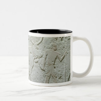 Herdsman leading a bull Two-Tone coffee mug