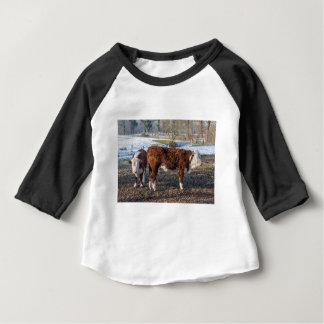 Hereford calves in winter meadow with snow baby T-Shirt